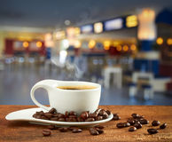Cup of hot coffee on blur background Royalty Free Stock Images