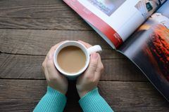 Coffee. In hand  & book, the best friends Stock Photography