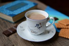 Cup of hot coffee, cookies and book Royalty Free Stock Image