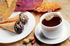 Cup of hot coffee with cakes Stock Photo