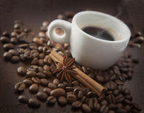 Cup of hot coffee with chinnamon, anise Royalty Free Stock Photo