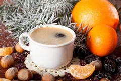 Cup of hot coffee with Christmas decorations Royalty Free Stock Images