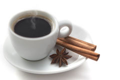 Cup of hot coffee with cinnamon and anise Royalty Free Stock Photography