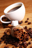 Cup of hot coffee and cinnamon sticks Royalty Free Stock Images