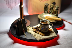 Cup of hot coffee with coffee beans and copper ashtray with a big cigar Royalty Free Stock Photo