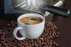 cup of hot coffee with coffee beans Royalty Free Stock Photo