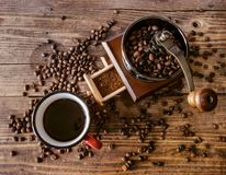 Hot coffee cup with coffee bean grinder royalty free stock photography