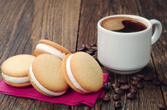 Cup of hot coffee and cookies Stock Photography