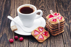 Cup of hot coffee and cookies tied ribbon Stock Photography
