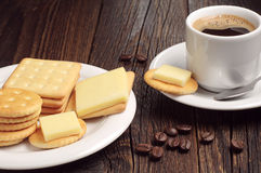 Cup of hot coffee and crackers Royalty Free Stock Photo