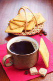 Cup of hot coffee and crackers Royalty Free Stock Photography