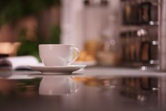 Cup of hot coffee. On blurred background Royalty Free Stock Photo