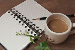 A cup of hot coffee, flowers and book, Romantic background.  Royalty Free Stock Image