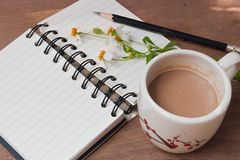 A cup of hot coffee, flowers and book, Romantic background Royalty Free Stock Photography