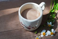 A cup of hot coffee, flowers romantic background.  Stock Images