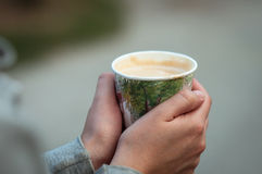 Cup of hot coffee in hand Royalty Free Stock Photo