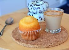 Cup of hot coffee and homemade sweet muffin and donuts. Royalty Free Stock Photography