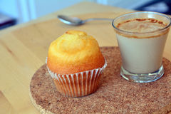 Cup of hot coffee and homemade sweet muffin. Royalty Free Stock Photo