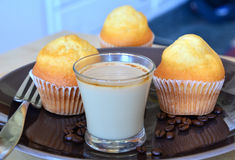 Cup of hot coffee and homemade sweet muffins. Royalty Free Stock Images