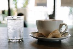 Cup of hot coffee and ice drinking water stock photo