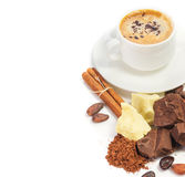 Cup of hot coffee and ingredients for making chocolate Stock Image