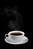 A cup of hot coffee isolated on a black background. Royalty Free Stock Photography