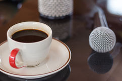 Cup of hot coffee in music  on black  background. Cup of hot coffee in music  morning on black  background Royalty Free Stock Photos