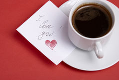Cup with hot coffee and note Royalty Free Stock Images