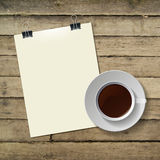 Cup of hot coffee and note paper on wood Stock Images