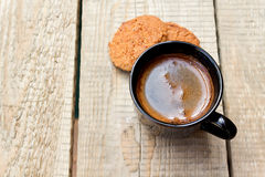 A cup of hot coffee and oatmeal cookies in the early morning Stock Photography