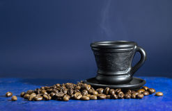 Cup of hot coffee on the old blue background. A cup of hot coffee on the old blue background stock photos