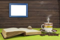 Cup of hot coffee and old book. Relaxing at the coffee. Studying old books. Place for your text. Stock Photos