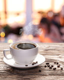 Cup of hot coffee on a old wooden table. Royalty Free Stock Photography