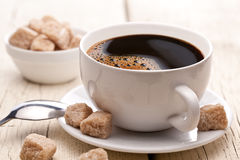 Cup of hot coffee on an old wooden table. Stock Photo