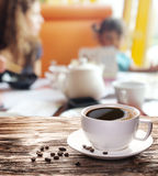 Cup of hot coffee on a old wooden table. Stock Photography