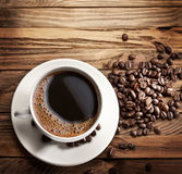 Cup of hot coffee on a old wooden table. Royalty Free Stock Image