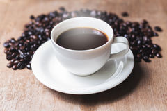 Cup of hot coffee on a old Royalty Free Stock Images