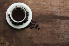 Cup of hot coffee on a old wooden Royalty Free Stock Photos