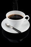 Cup of hot coffee over black background Royalty Free Stock Images
