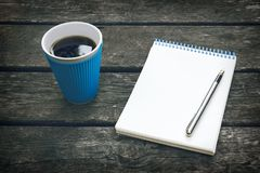 Cup of hot coffee, pen and notepad, blank sheet of paper. Business plan. Writing poetry. Stock Image