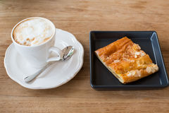 Cup of hot coffee and pie Royalty Free Stock Photography