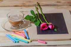 Hot coffee on pinewood tabel with pastel. A cup of hot coffee put on rainwood table with pastel color Stock Photography