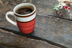 A cup of hot coffee on rustic wooden table Stock Photos