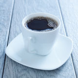 Cup of hot coffee on saucer Stock Images