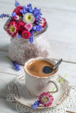 Cup of hot coffee and spring flowers Royalty Free Stock Image