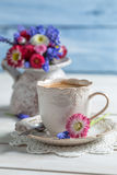 Cup of hot coffee and spring flowers Royalty Free Stock Photo