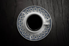 A cup of hot coffee standing on the wooden table. Object photography. Top view Stock Image