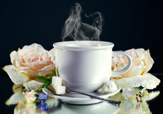Cup of hot coffee with steam on dark background Royalty Free Stock Image