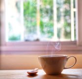 A cup of hot coffee steam smoke stock image