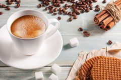A cup of hot coffee with sugar, Belgian waffles and cinnamon Stock Image
